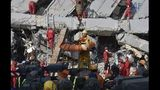 100 people trapped under rubble after Taiwan quake