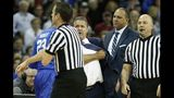 Kentucky's John Calipari tossed from game, held back by players