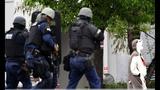 Man in hedgehog suit shot after TV station bomb threat