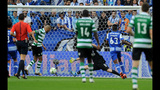 Sporting beats Porto 3-1 to stay in Portuguese title fight