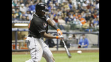 Marlins hit four homers in 7-5 win over Brewers