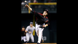 Greinke solid but Diamondbacks lose late to Rockies