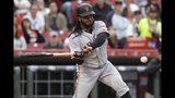 Cueto roughed up but Giants rally for 9-6 win over Reds