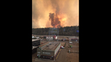 Wildfire guts large swath of Canadian city; 88,000 flee