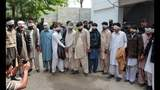 Pakistan police arrest 13 for burning girl in 'honor killing'