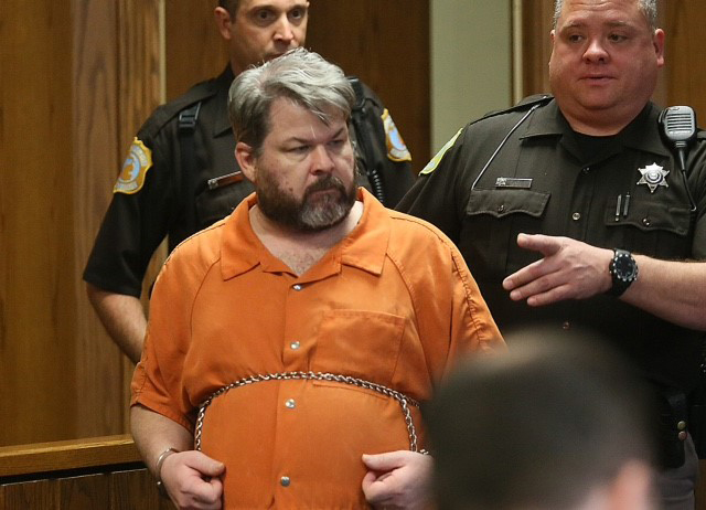 Kalamazoo shooting suspect hauled out of court