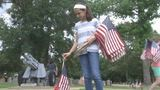Girl Scouts spend hours placing American flags on veterans' graves